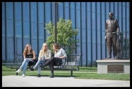 3 students sitting on a bench